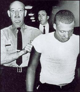 Officer escorting Ray Crump Jr.
